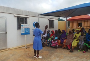 Patients waiting at one of ePHC's clinic while a nurse gives directives.